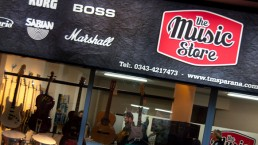 The music store cartel Fachada diseño gráfico